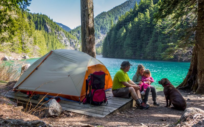 Family camping near a lake
