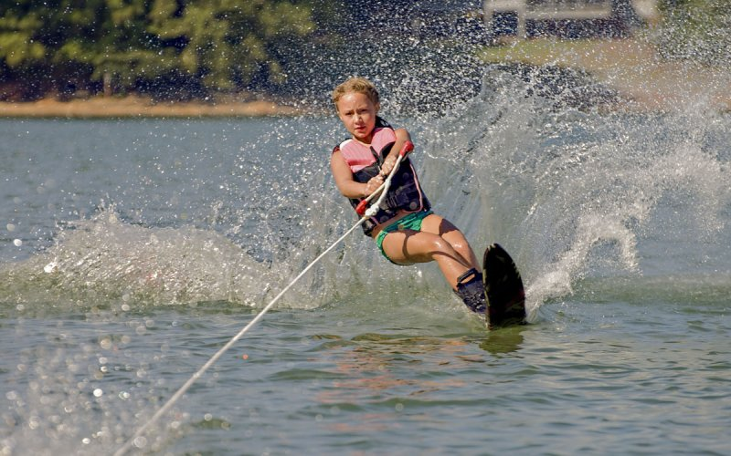 Young girl water skiing